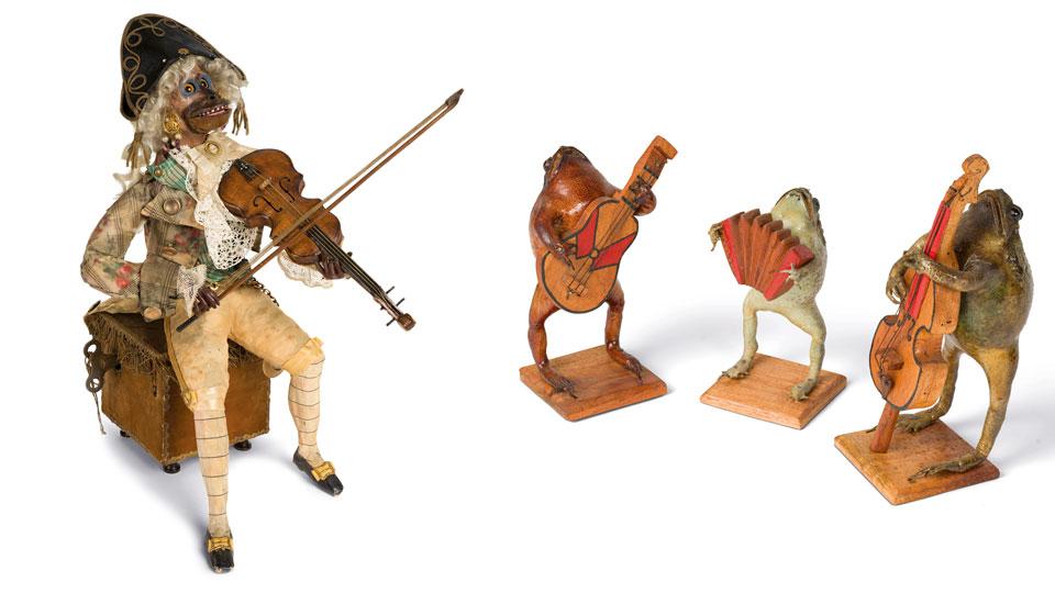 Musizierende Aga-Kröten und ein geigenspielender Affe