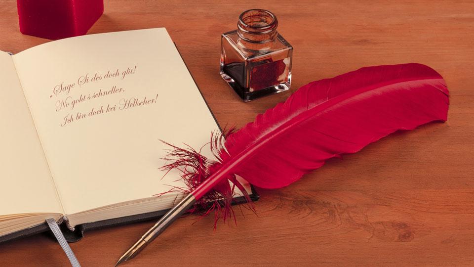 Buch mit Schreibfeder